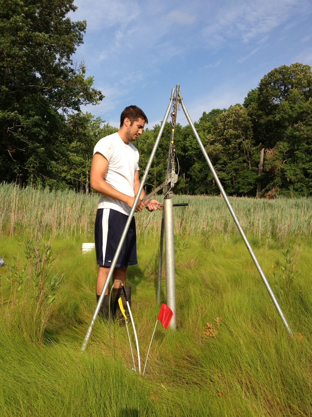 Justin Meschter, MEES M.S. student, taking sediment cores for research on below ground biogeochemistry.