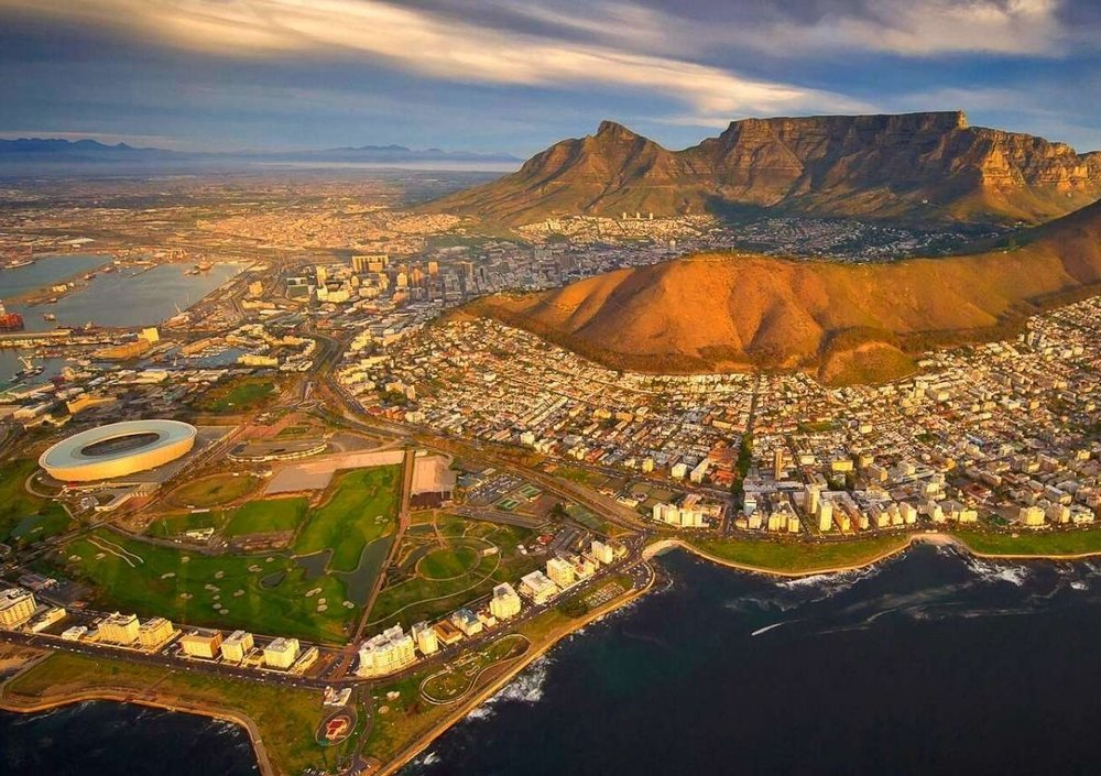 Part Two - Cape Town  - Resting at the confluence of the Indian and Atlantic Ocean, sandwiched between the slopes of the iconic Table Mountain and the glistening sapphire waters of Table Bay, the exceptionally scenic city of Cape Town is in a class of its own.