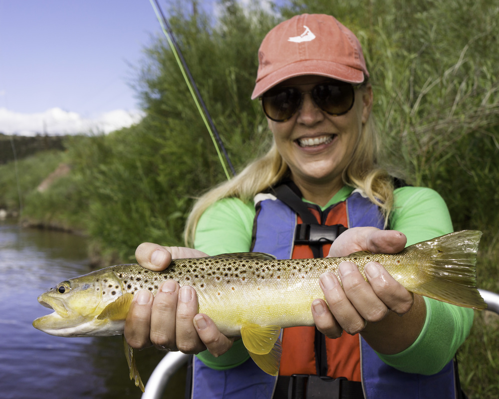 Happy Angler with a Brown Trout