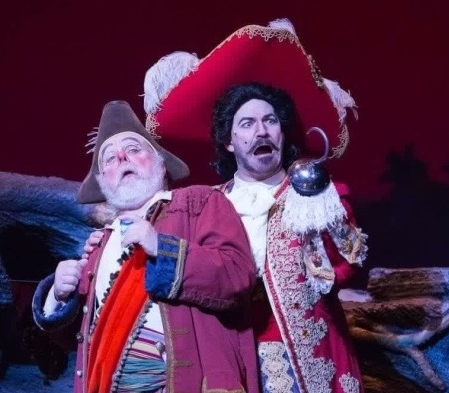 """ The best part of peter pan is easily captain hook (michael scott harris).  Harris's hook is flamboyant, over-confident, and speaks with a boisterous baritone. it's almost impossible not to laugh as hook demands that his pirates play ""hook's tango"" as he details his nefarious plot to murder peter pan and the lost boys""    - anchorage press"