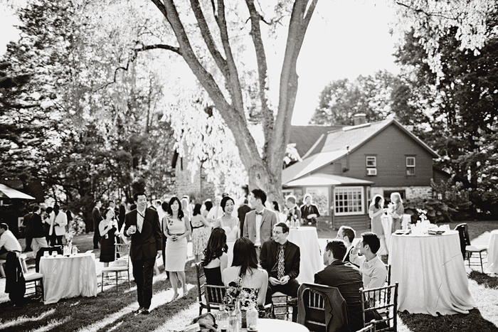 rustic barn wedding cocktail hour under trees