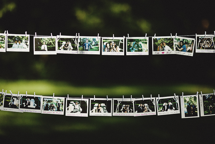polaroid wedding guest book hung on string