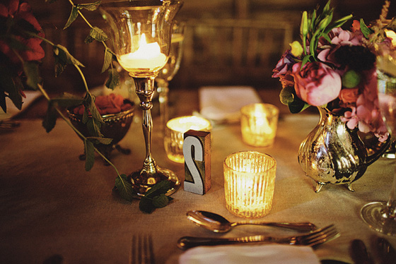 candlelit table with letterpress block table numbers