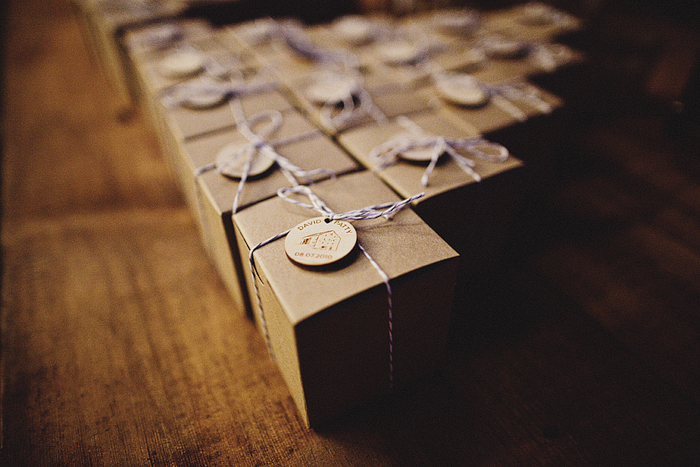 kraft box favors tied with bakers twine and wooden disks