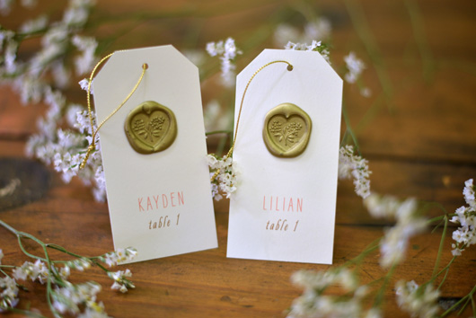escort card detail with wax seals