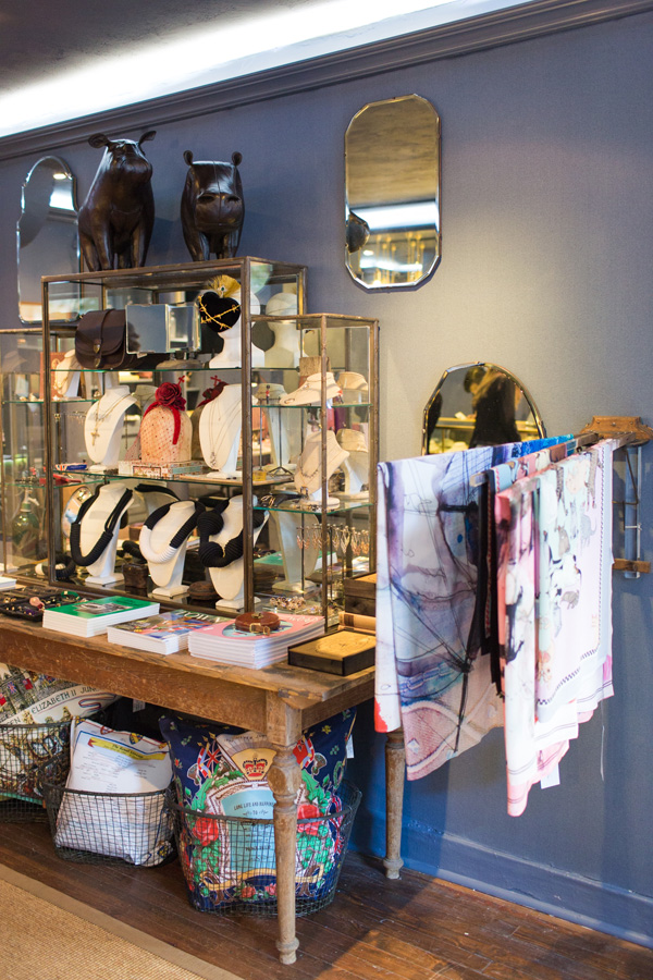Display cases, jewelry scarves, and pillows at Flat 128