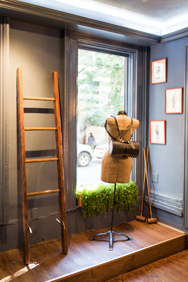 Vintage ladder, dress form, and croquet sticks at Flat 128