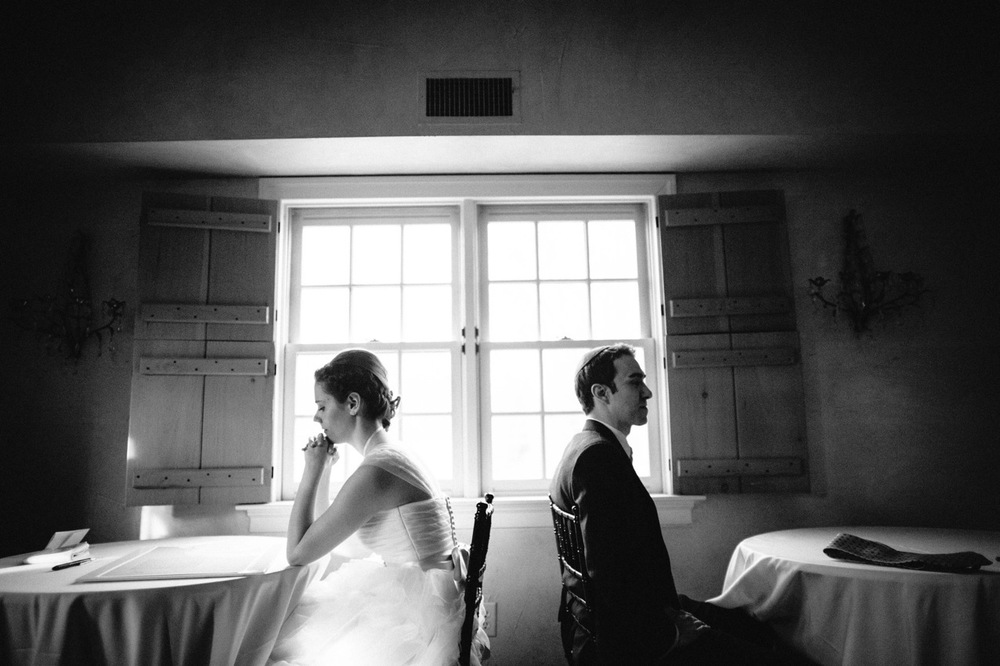 Bride and Groom sitting at tables