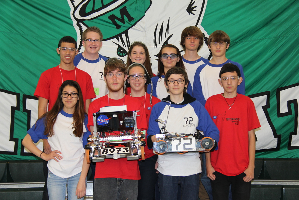 Members from 72 GarageBots and 8973 Totes MaGoats at the competition