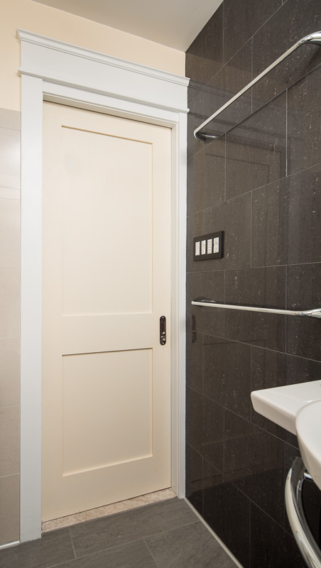 The pocket door gains valuable space in the 5 foot by 8 foot room.