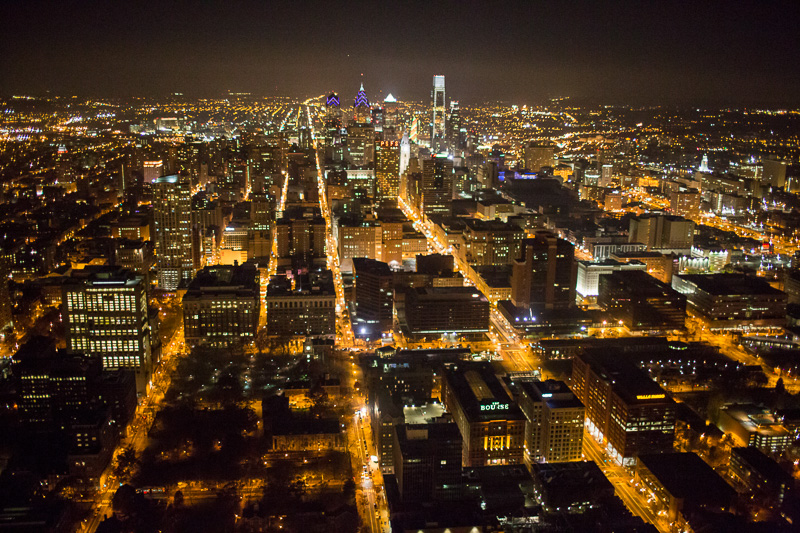 Philadelphia turns into glowing pockets of light when photographed from above at night.