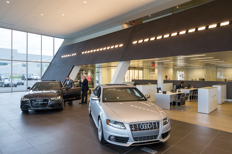 Clean lines and angled walls energize the space and reflect Audi's signature design aesthetic.