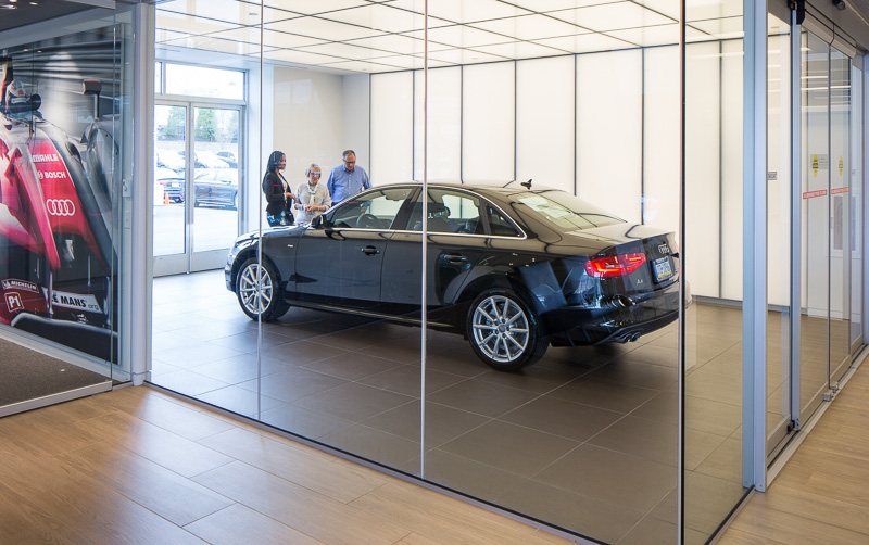 Customers take delivery of their new Audi in a custom-designed glass room — a truly special moment, above and beyond a typical car-buying experience.