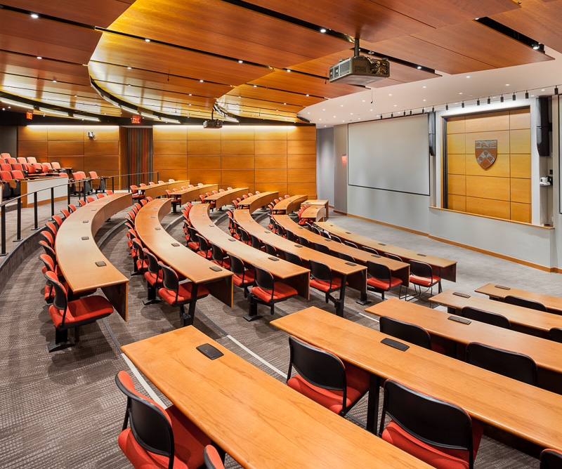 The spacious Fitts Auditorium features warm wood tones and a variety of lighting levels to respond to student's and faculty's needs.