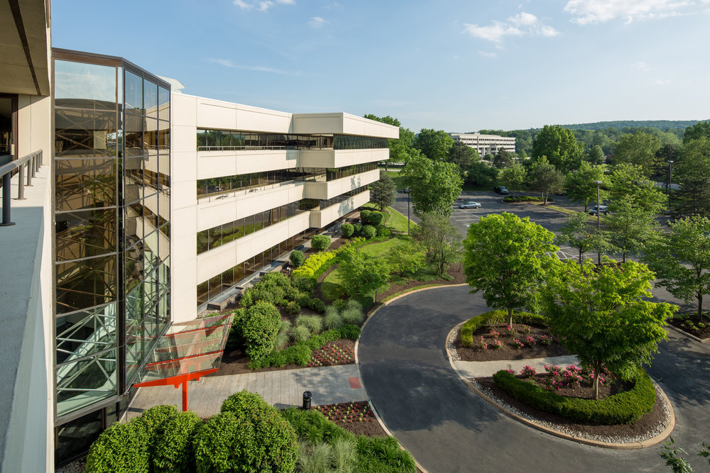 Triad, a revitalized suburban office building in a park-like setting.