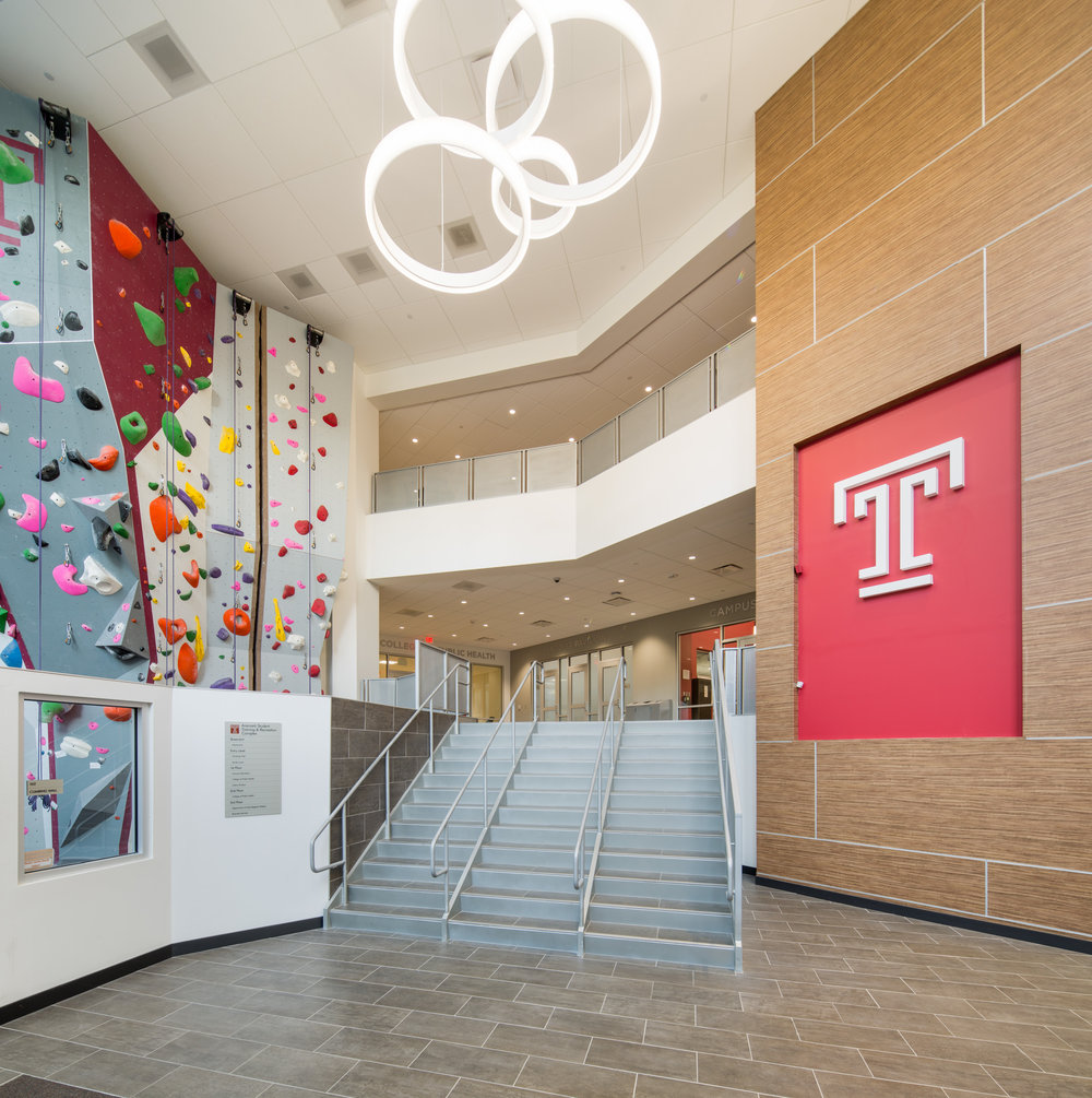 A super wide architectural tilt-shift lens captured the two-and-a-half-story glass atrium entrance and climbing wall