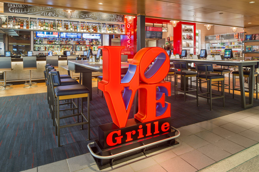 Love Grille with the iconic Love statue logo, features Philly cheesesteaks.