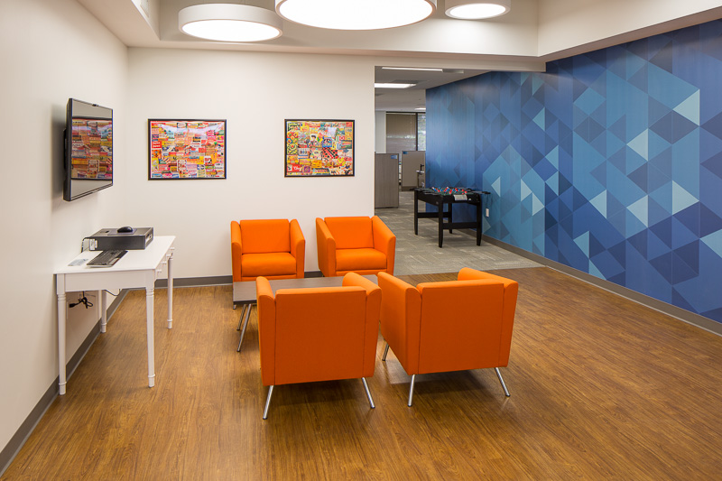 Complimentary colors orange and blue define this space