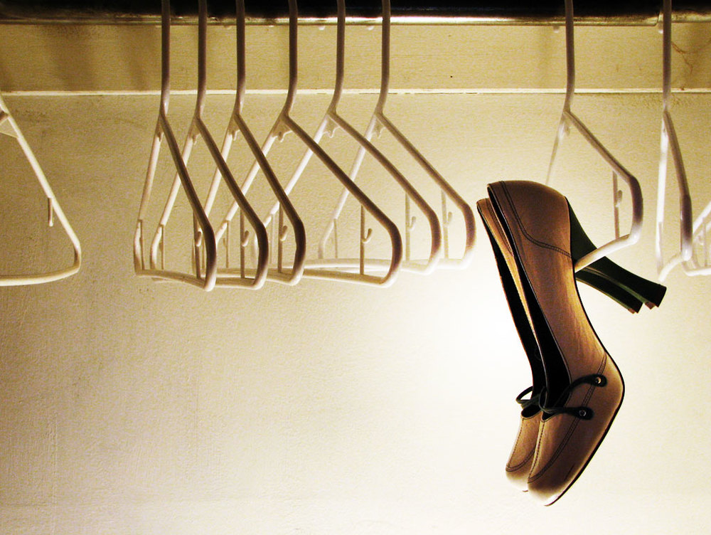 gold shoes on a hanger.jpg