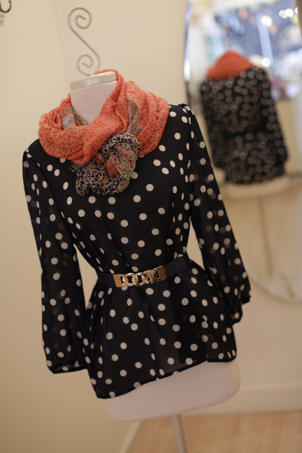 This adorable polka-dot blouse is loose fitting for a style that is  comfortable yet flattering and can be paired with a belt and scarf for a little extra glam. This top is flying off the shelves so hurry in so you don't miss it!