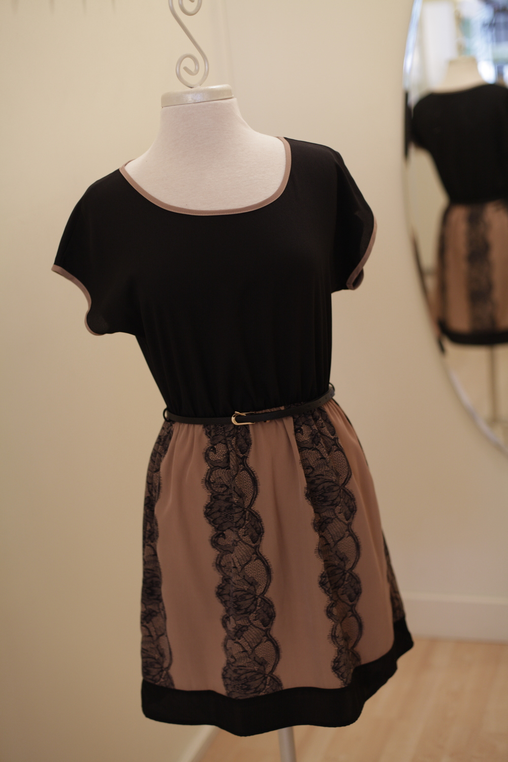 You can't go wrong with this little number. It's a perfect option for a holiday work party or a family gathering. The black lace and skinny belt add just enough to keep it sophisticated and sassy.
