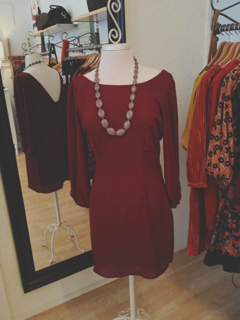 Maroon holiday dress with open back and zipper.