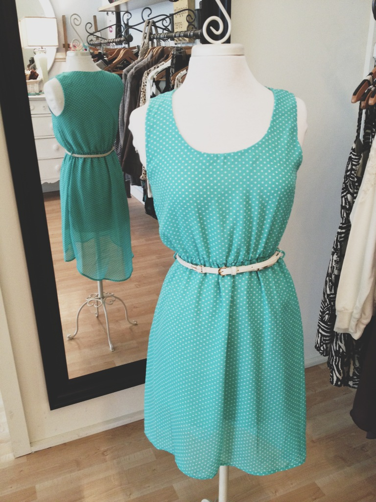 Belted turquoise dress with white polka dots