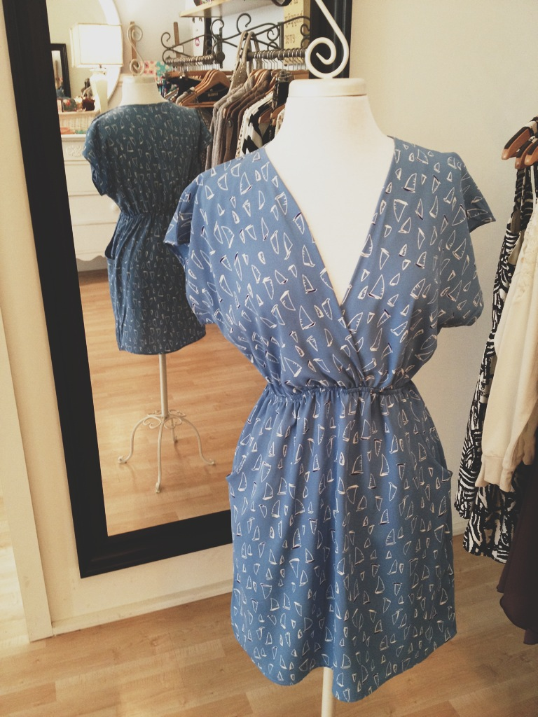 Blue spring dress with sailboat pattern