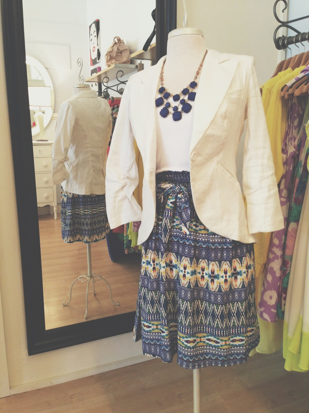 One of our super cute tribal print dresses, layered with our white linen blazer.