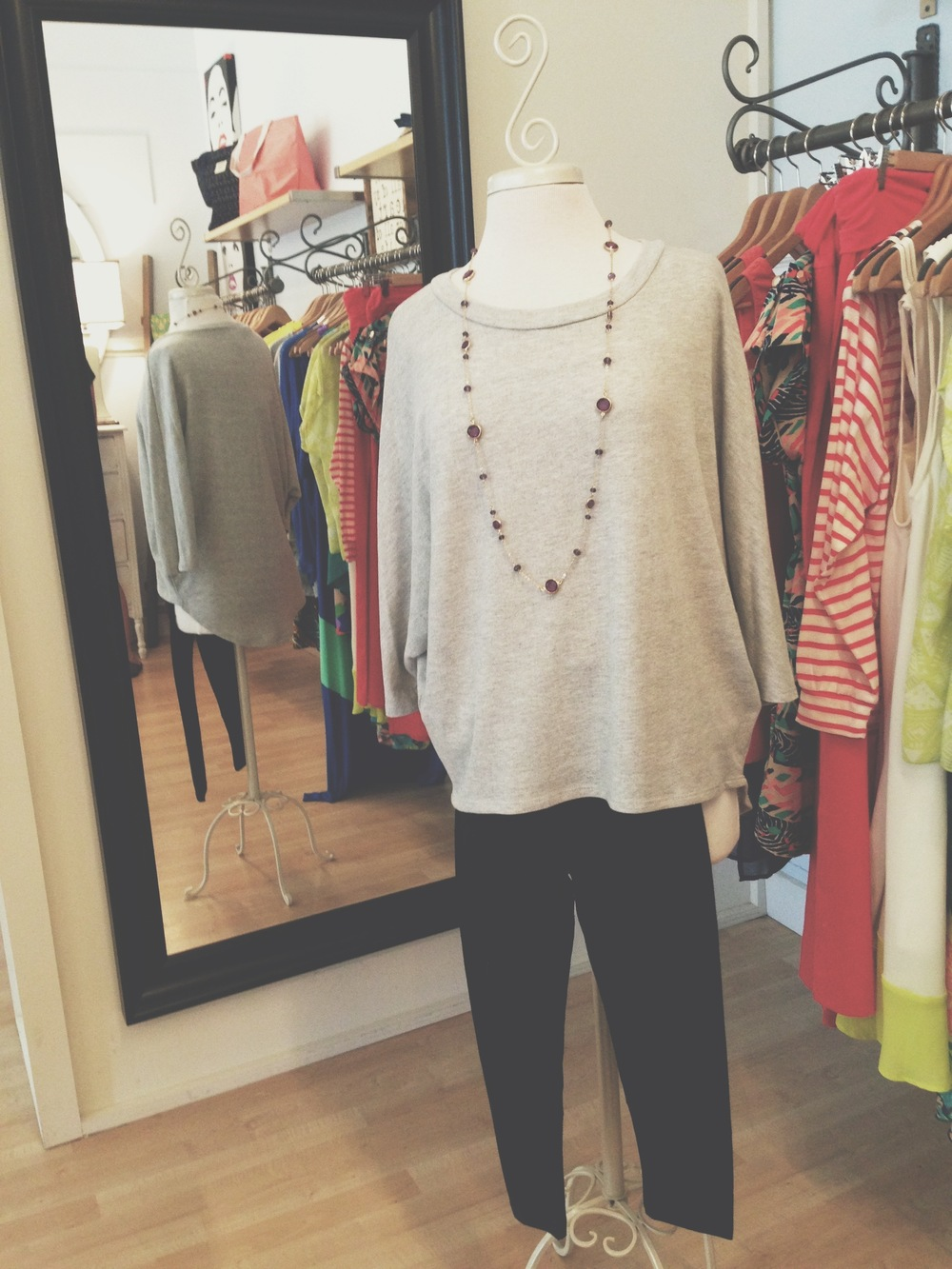 Grey sweatshirt top, paired with our black essential leggings, and necklace.