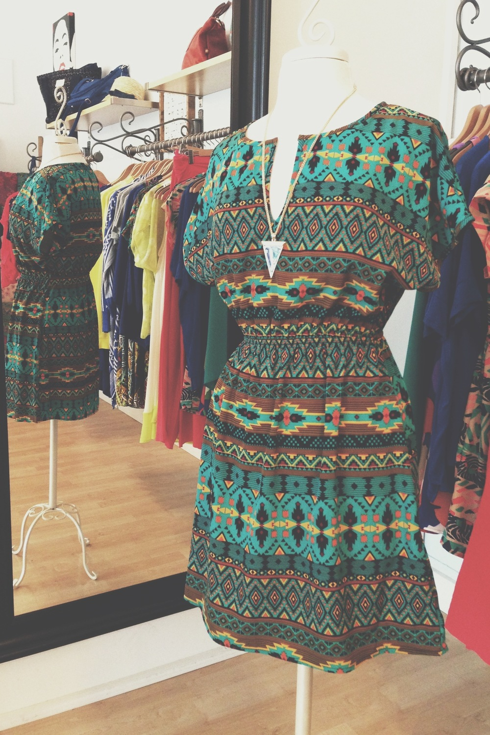 Green Aztec print dress, with arrowhead necklace.
