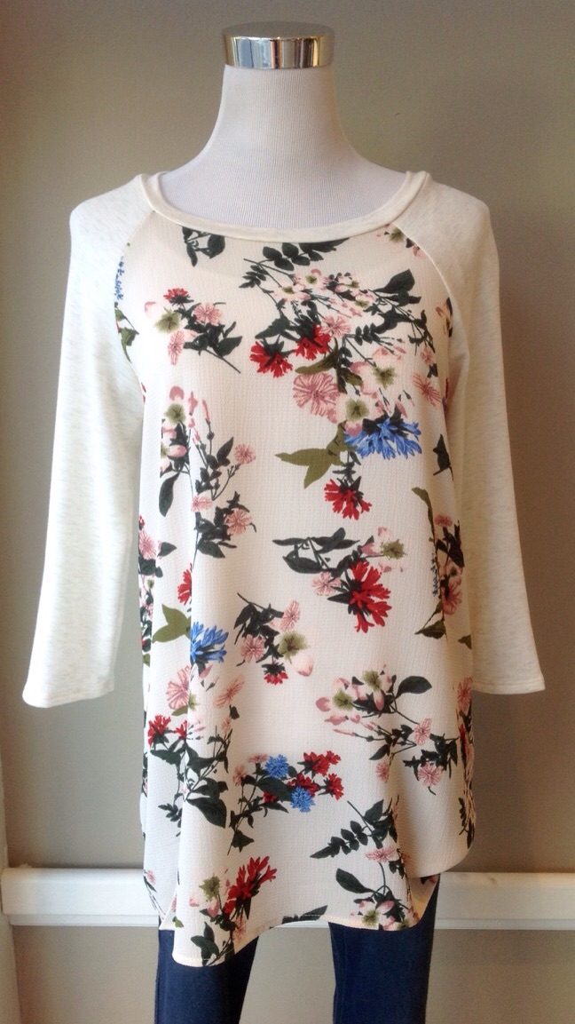Ivory high-low hem tunic top with floral crepe front, $34