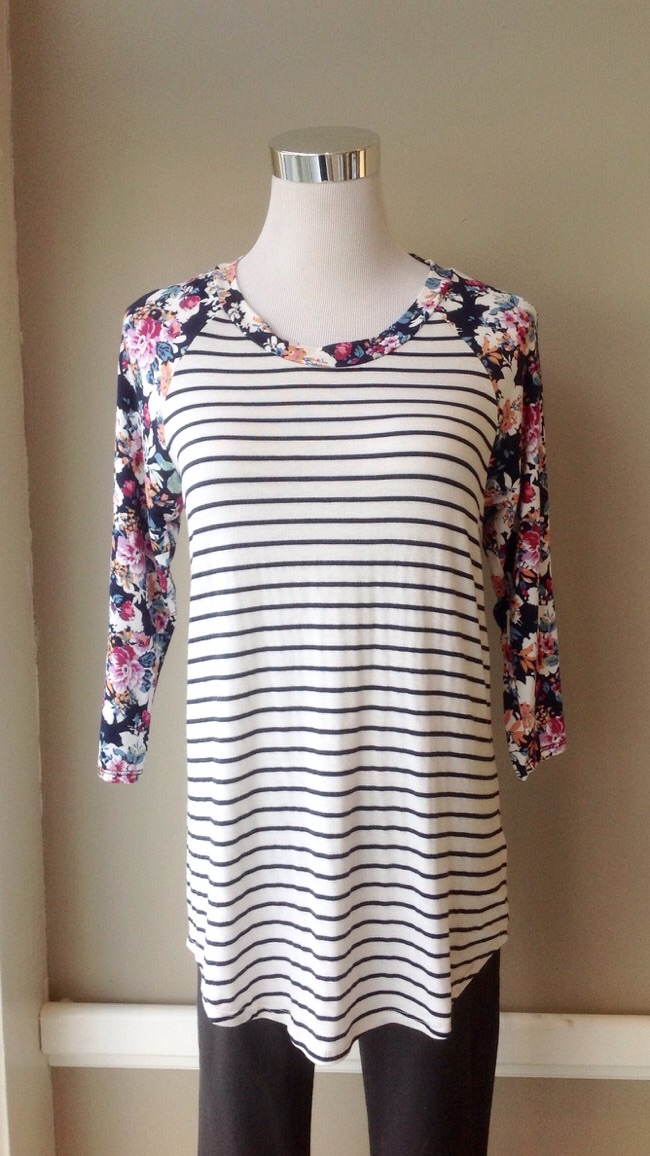 Black and white stripe baseball top with floral print sleeves, $28
