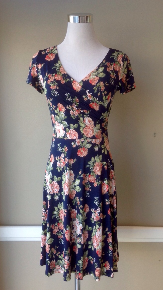 Fully lined faux wrap style dress in navy floral jersey knit, $45