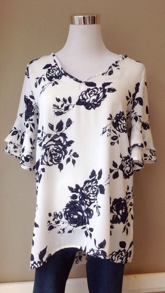 Floral v-neck blouse with ruffle sleeve and high-low hem in white/navy, $35