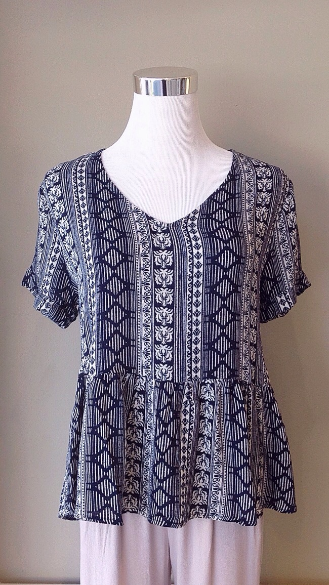 Printed peplum top in navy/white, $34