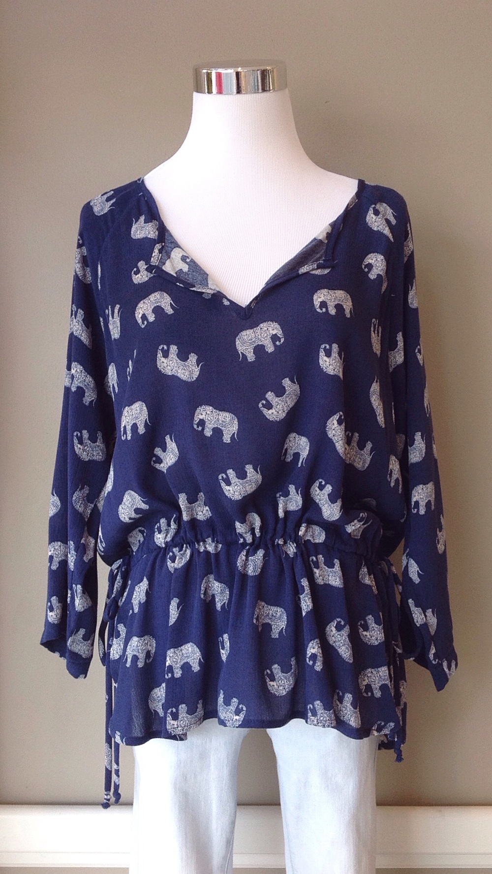 Woven elephant print blouse with adjustable waist ties, $34