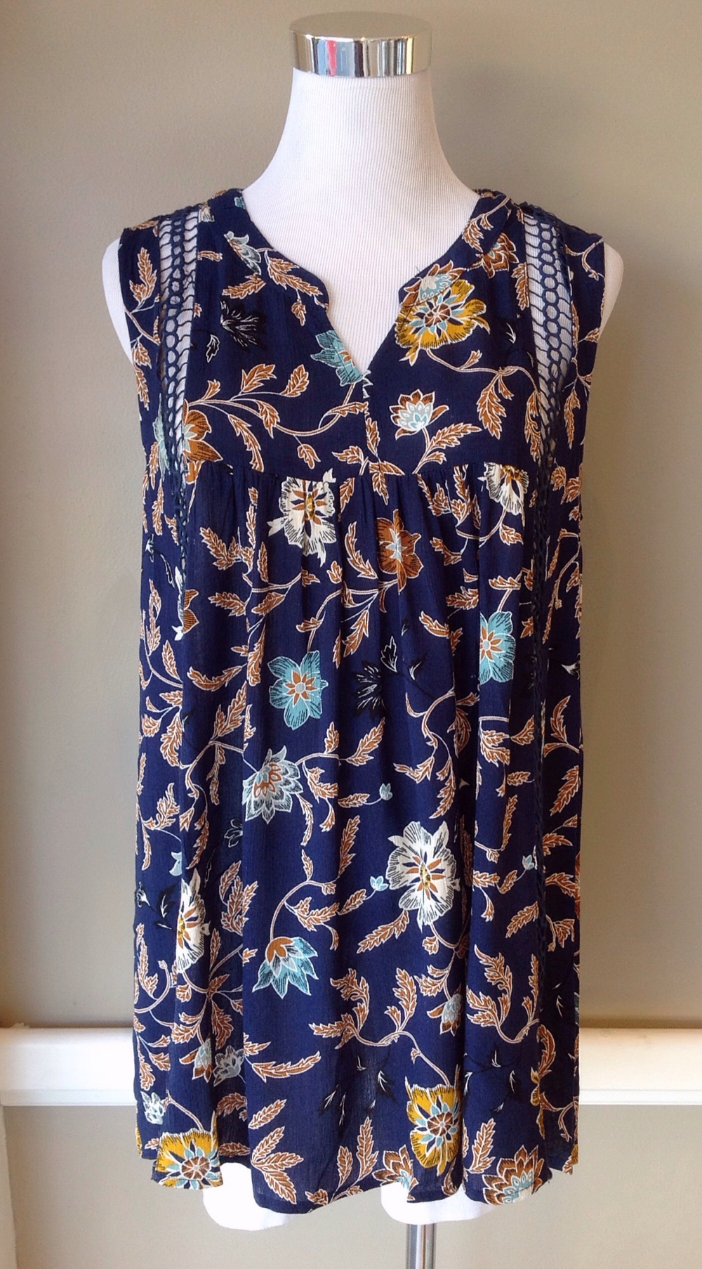 Navy floral print tank with lace trim, $34
