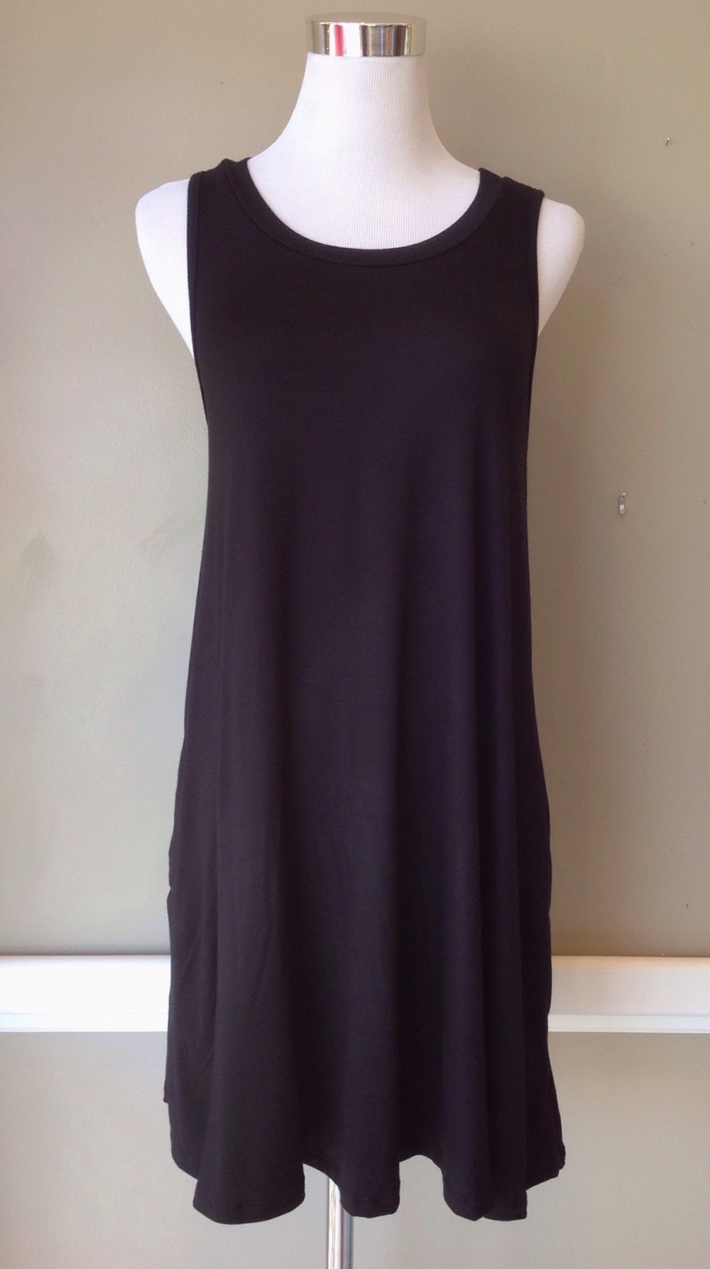 Black knit tank dress with side pockets, $34