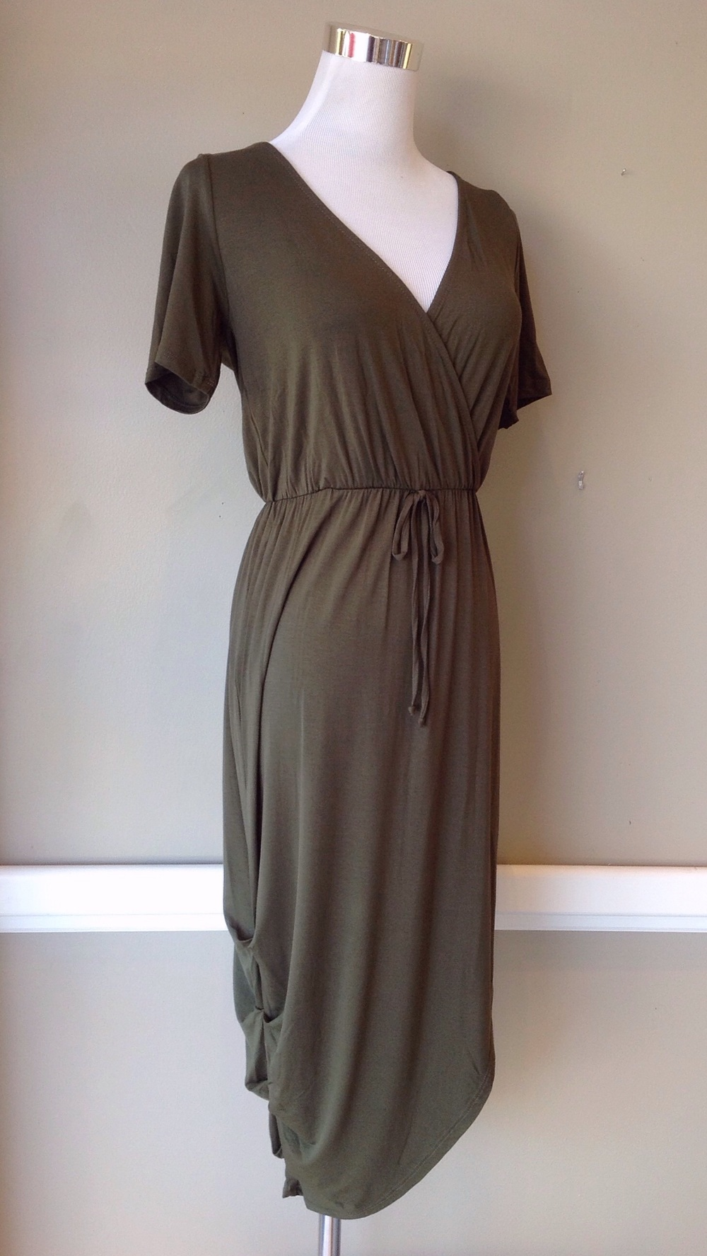 Olive knit dress with drawstring waist and ruched side seam, $42