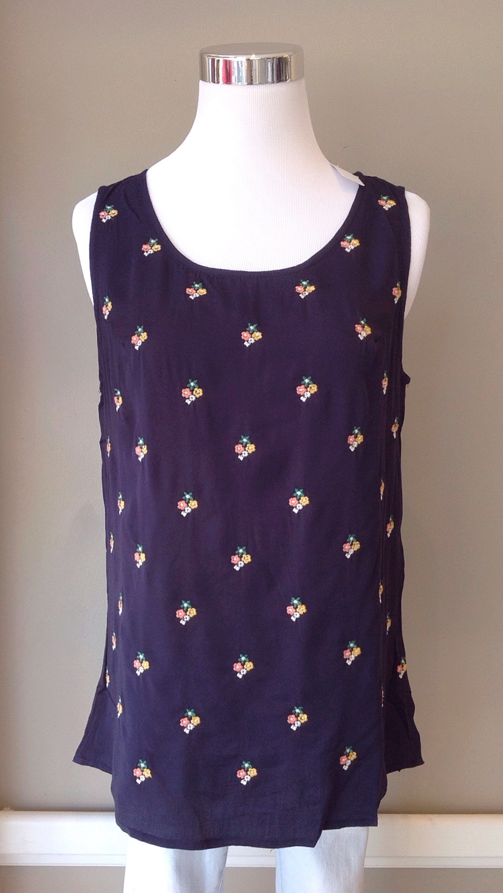 Navy woven tank with embroidered flower print, $34