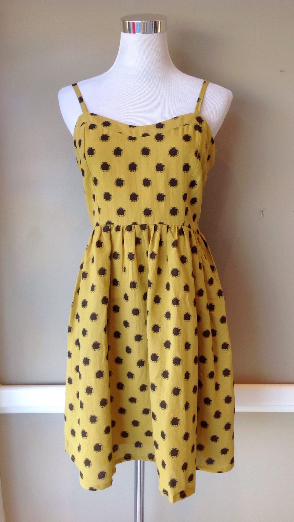 Cotton and linen fit and flare dress with spaghetti straps in mustard, $42
