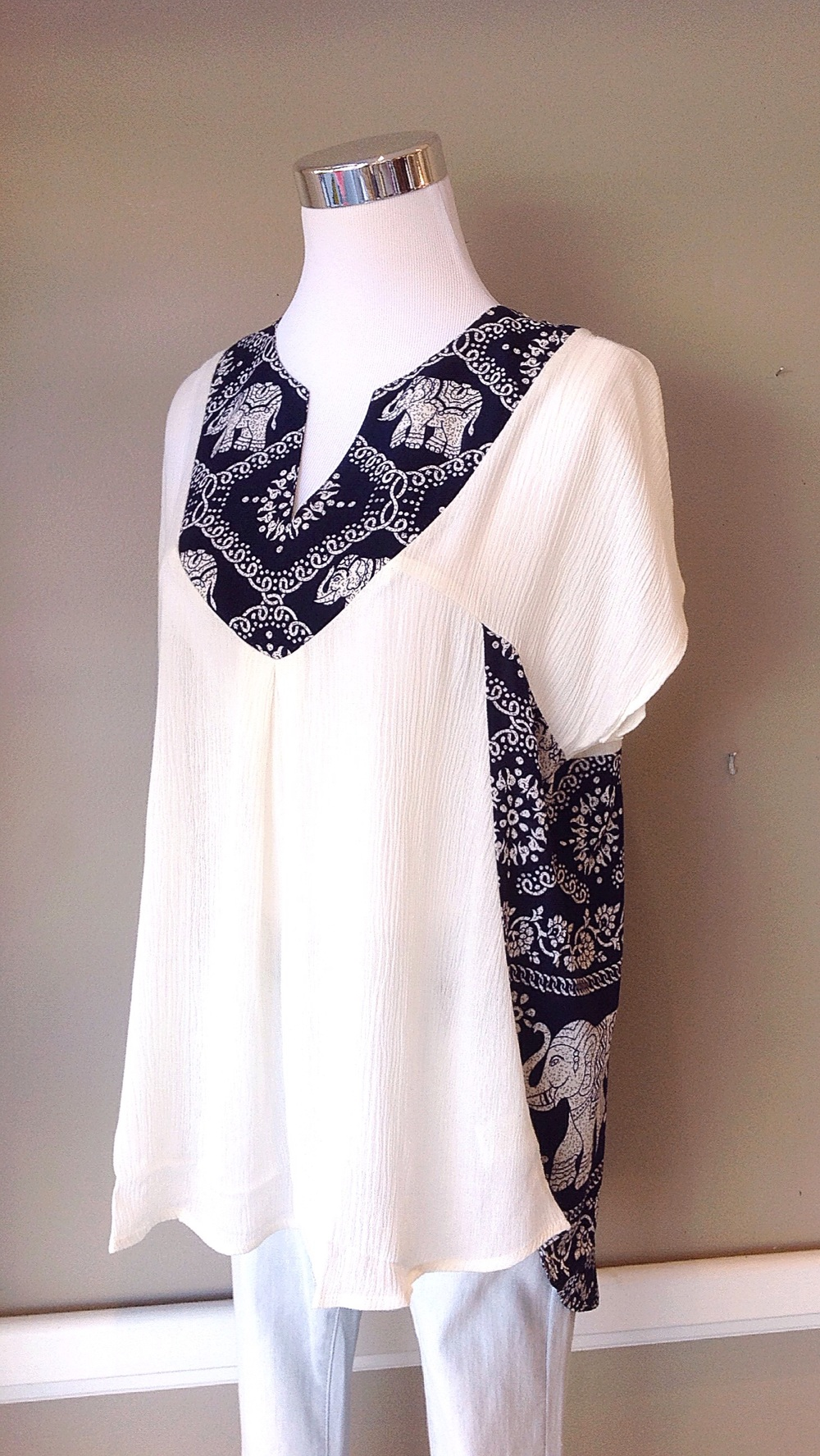 Woven cream blouse with contrasting navy elephant print, $34