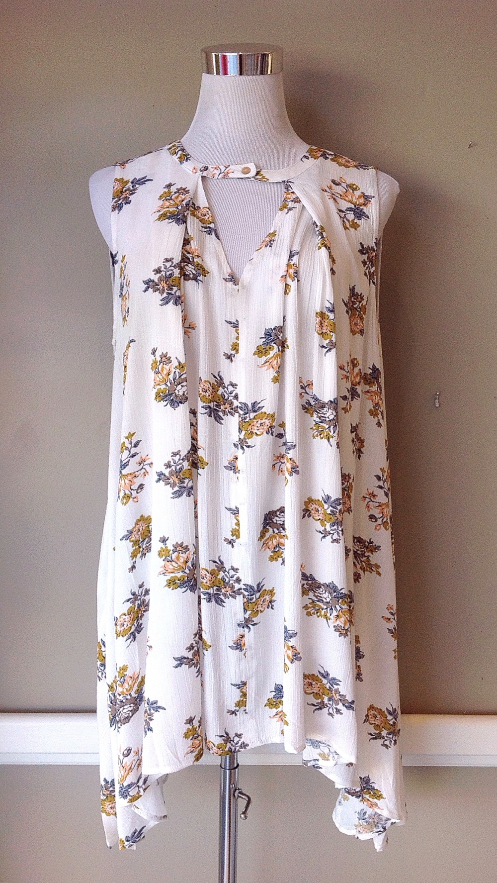 Floral print dress with handkerchief hem and front keyhole, $35