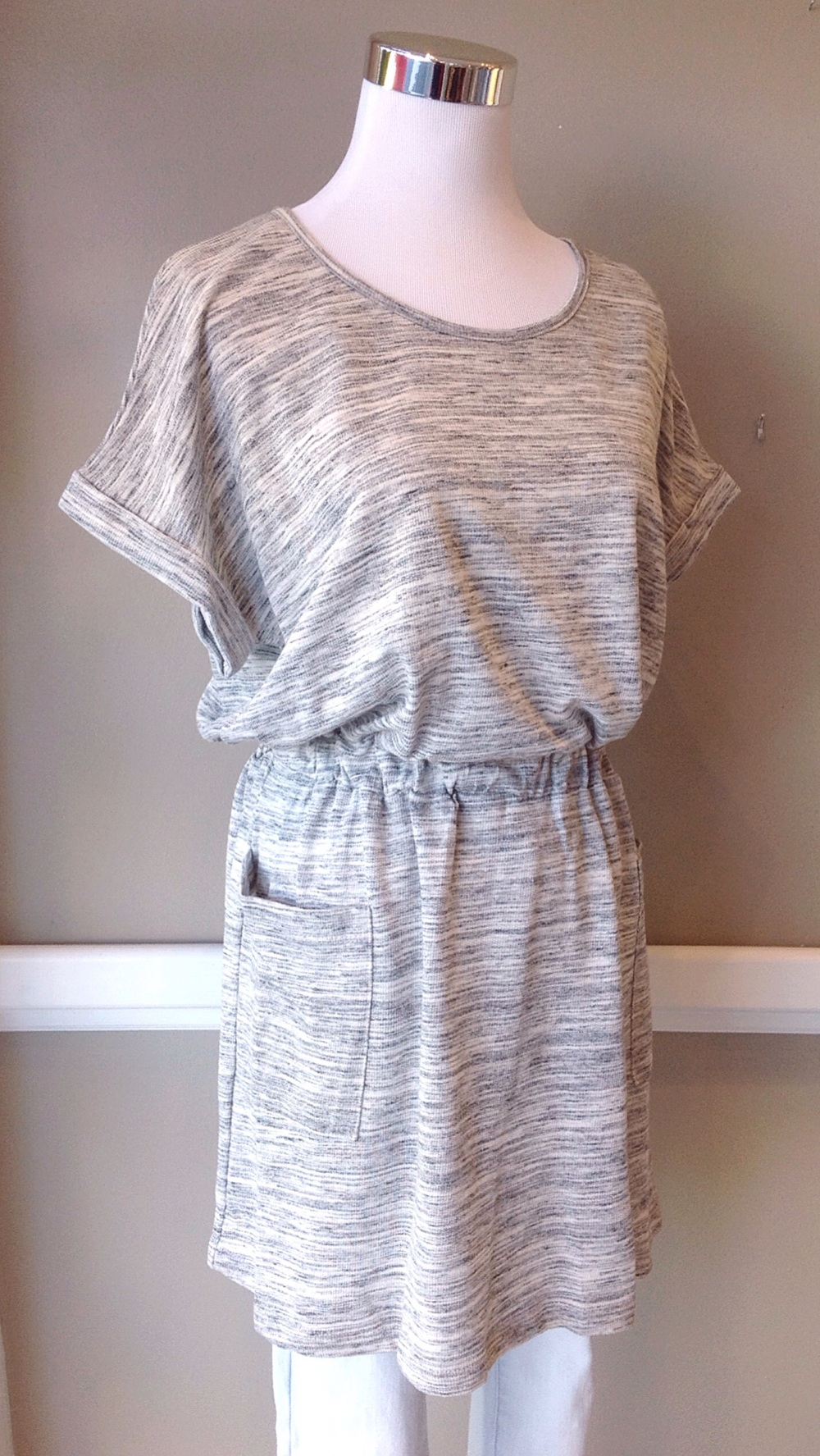 Lightweight knit tunic with elastic waist and patch pockets in off-white/grey, $34