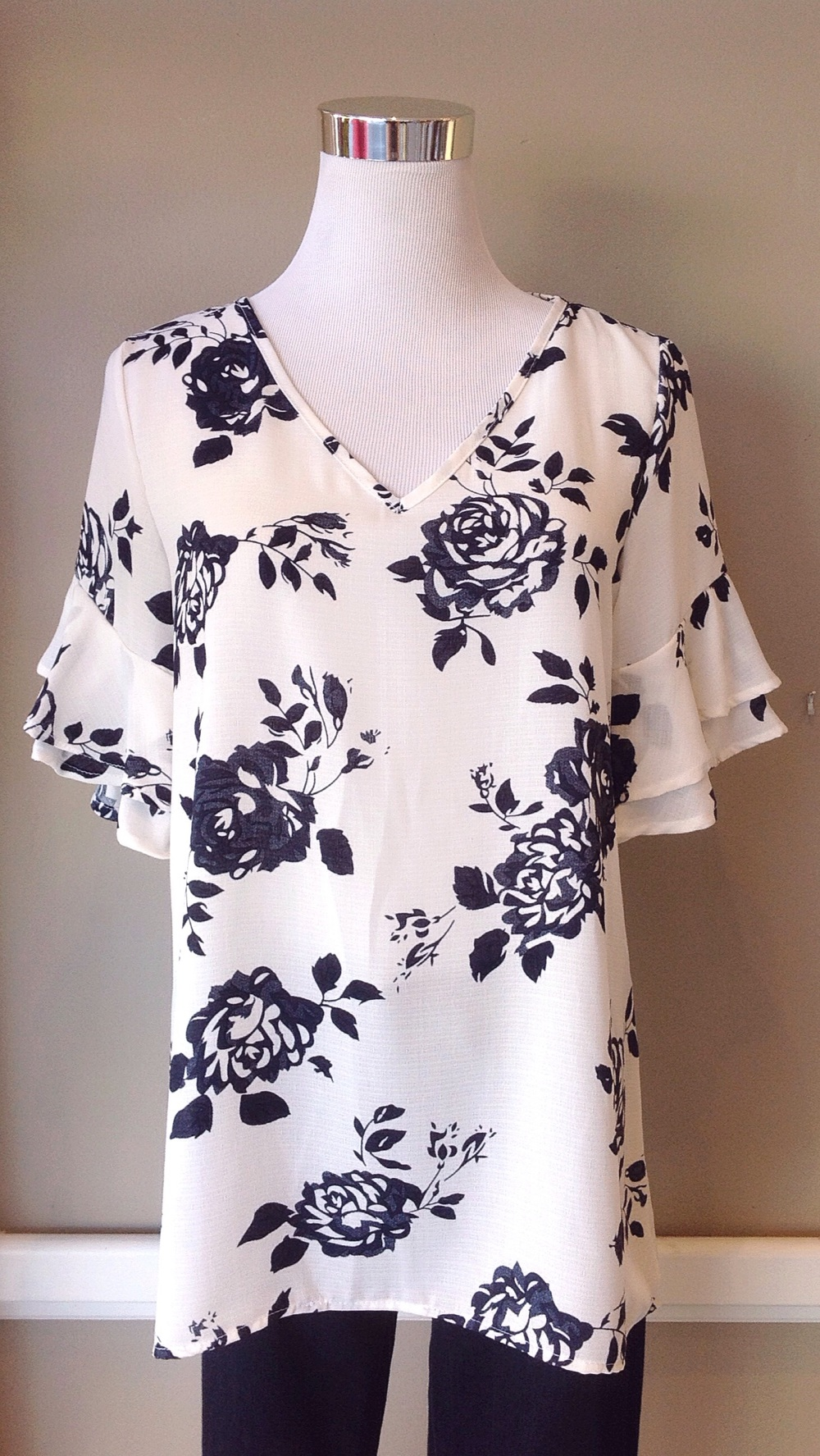 Woven floral print blouse with ruffled short sleeves in ivory/dark navy, $34