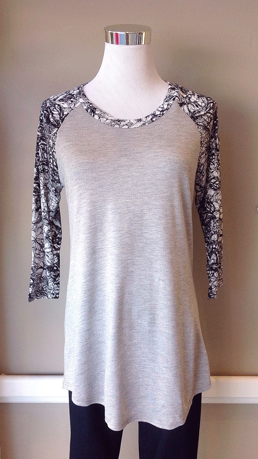 Grey baseball top with charcoal/black floral sleeves, $28