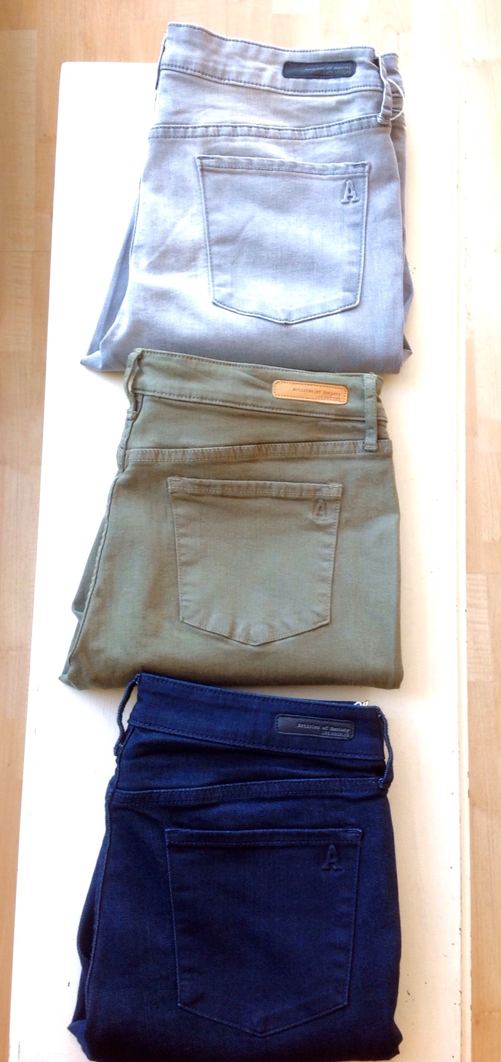 Articles of Society skinny jeans in dark wash, olive, and light grey, $59 & $64