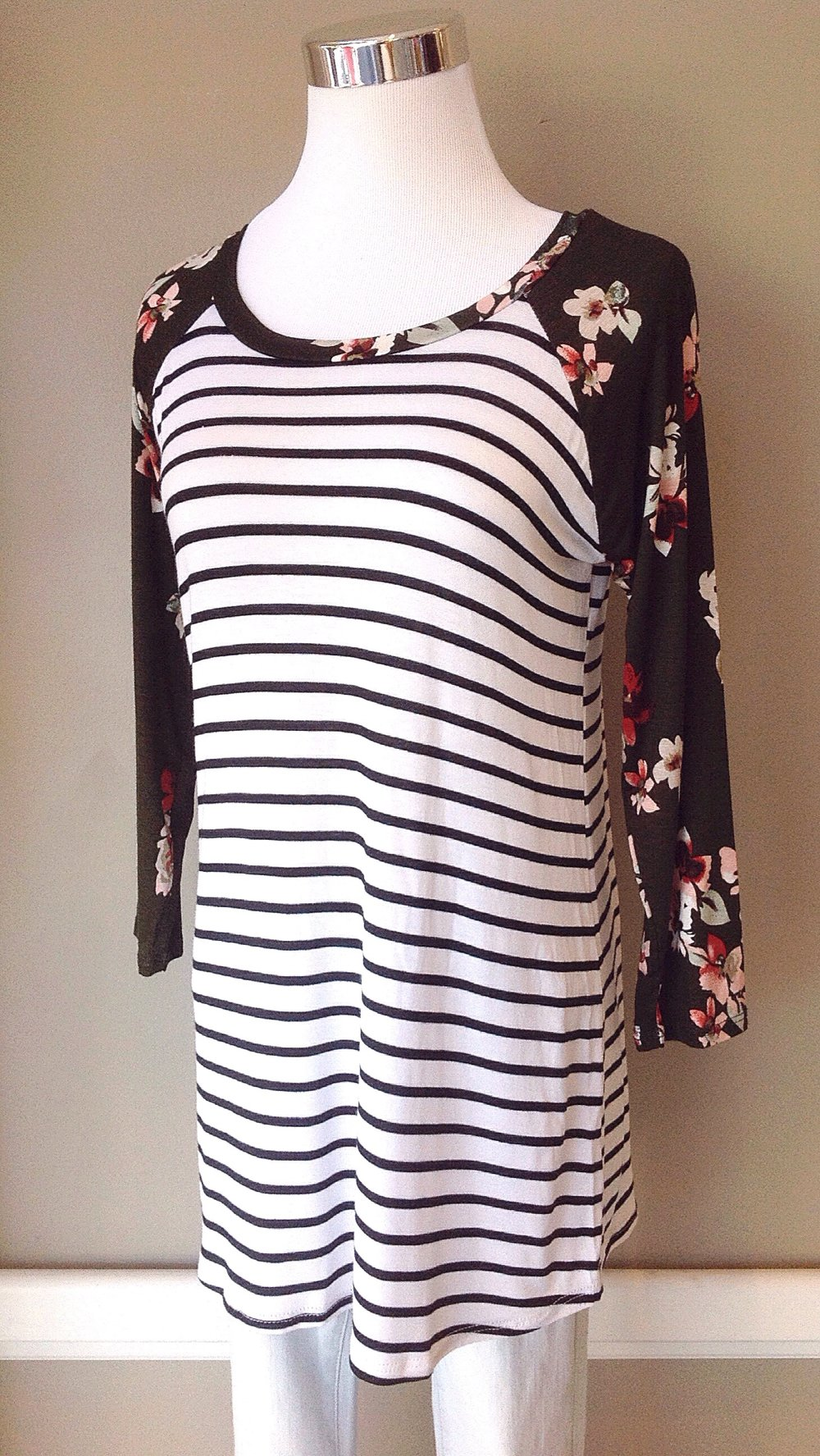 Stripe knit baseball top with contrast floral sleeves, $28