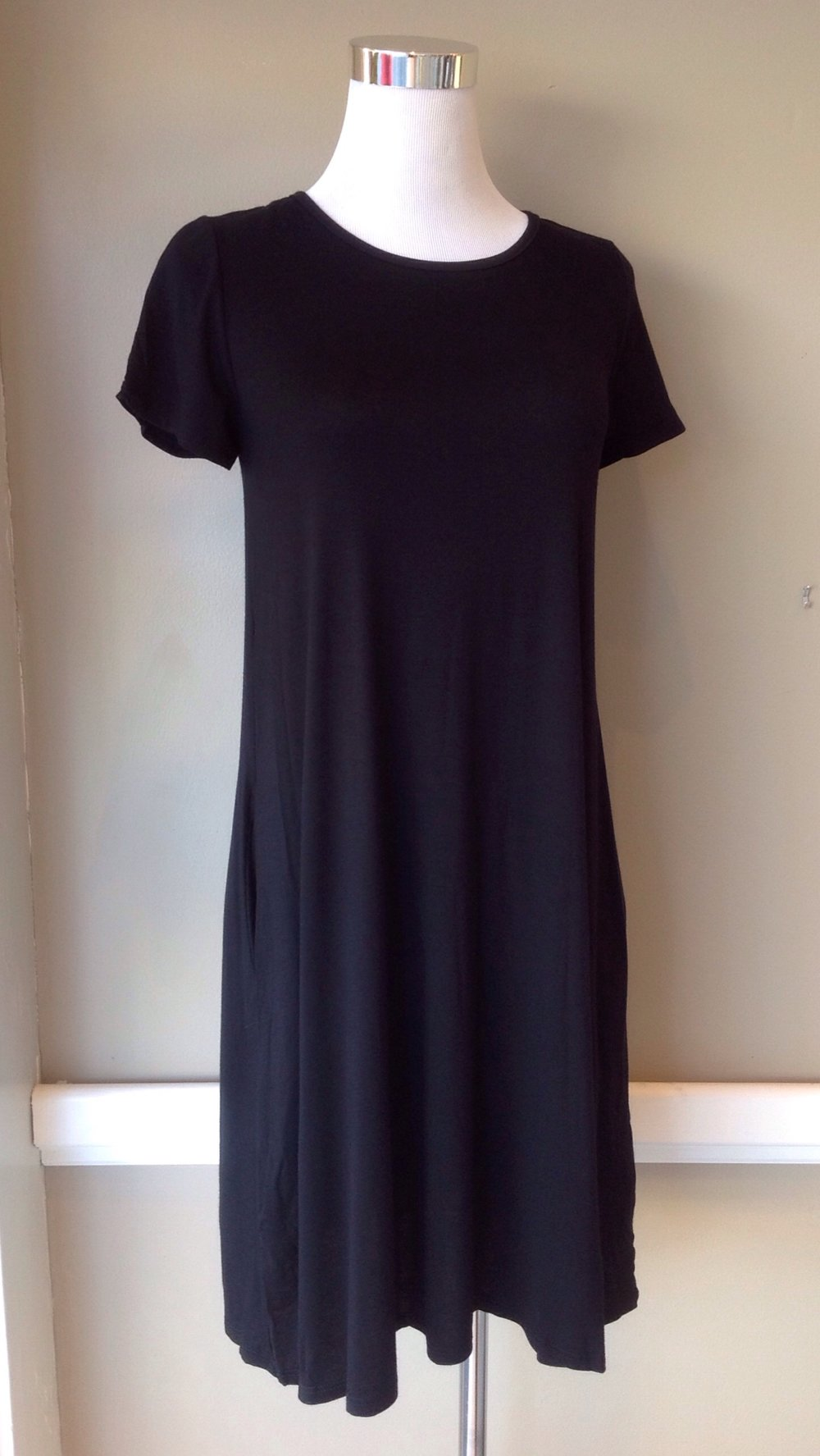 Black short sleeve t-shirt dress with side pockets, $34